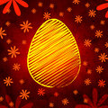 Yellow easter egg over brown old paper background with flowers Royalty Free Stock Photo