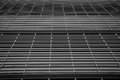 Stripes and rectangles architectural details of an urban office building form shown in black white Royalty Free Stock Photo