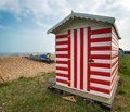 Stripey beach hut red and white at greatstone in kent Royalty Free Stock Photography