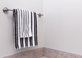 Stripped bathroom towels on towel holder Royalty Free Stock Photo