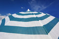 Stripped beach parasol at blue sky detail of Royalty Free Stock Photos