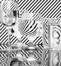 Strips refraction in water glass with and reflection black white Stock Images