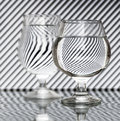 Strips refraction in water glass with and reflection black white Royalty Free Stock Image