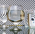 Strips refraction in water glass with and reflection black white Stock Photos