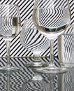 Strips refraction in water glass with and reflection black white Royalty Free Stock Photos