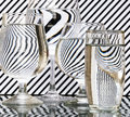 Strips refraction in water glass with and reflection black white Stock Photo