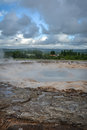 Strokkur geyser waiting to erupt in Iceland in summer Royalty Free Stock Photo