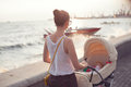 Strolling with newborn mother at seafront Royalty Free Stock Photo