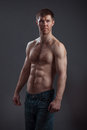 Strong athletic man on black background Royalty Free Stock Image