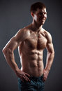 Strong athletic man on black background Royalty Free Stock Images