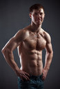 Strong athletic man on black background Royalty Free Stock Photography