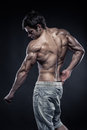 Strong athletic man fitness model posing back muscles triceps latissimus Royalty Free Stock Images