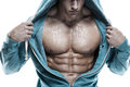 Strong athletic man fitness model torso showing six pack abs is Stock Photo