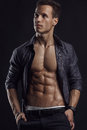 Strong athletic man fitness model torso showing six pack abs isolated on black background Royalty Free Stock Photos