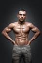 Strong Athletic Man Fitness Model Torso showing six pack abs. Royalty Free Stock Photo