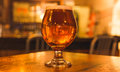 Strong Beer in Curved Glass Royalty Free Stock Photo