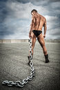 Strong bodybuilder with chain Royalty Free Stock Photo