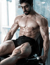 Strong bodybuilder training quads Royalty Free Stock Photo