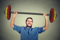Strong business man lifting barbell with two hands Royalty Free Stock Photo