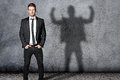 Strong business man with shadow Royalty Free Stock Photos