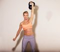 Strong Crossfit Woman with a Kettlebell Royalty Free Stock Photo