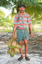 Strong deft man hold on a coconuts Royalty Free Stock Photo