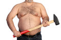 Strong fat man holding a big hammer on white background Royalty Free Stock Image
