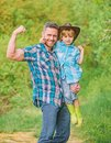 Strong father and son in cowboy hat on ranch. kid in rubber boots. happy man dad in forest. human and nature. family day Royalty Free Stock Photo