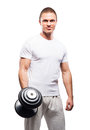 Strong, fit and sporty bodybuilder man holding a dumbbell Royalty Free Stock Photo