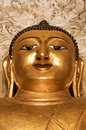 Strong golden meditating Buddha face with third eye Burma Myanma Royalty Free Stock Photo