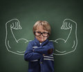 Strong man child showing bicep muscles concept for strength confidence or defence from bullying Royalty Free Stock Images
