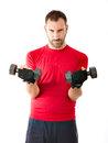 Strong man doing gym exercize with weights Royalty Free Stock Image