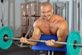 Strong man exercising  with barbell. Royalty Free Stock Photo