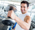 Strong man at the gym Stock Image