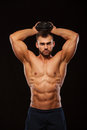 Strong man making exercises on triceps with a dumbbell. Close up shot training hands. Fitness Model showing his Torso Royalty Free Stock Photo