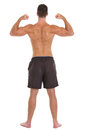 Strong man sports man showing muscular back Royalty Free Stock Images