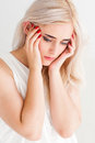Strong migraine, poor blonde woman with headache Royalty Free Stock Photo