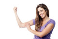 Strong pretty girl showing her biceps beautiful charming flexing Stock Images