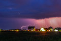 Strong Thunderstorm with rain over the village street Royalty Free Stock Photo