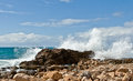 Strong waves, rocky shore, tropical Stock Images