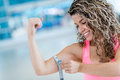 Strong woman at the gym measuring her biceps Stock Image