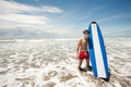 Strong young surf man portrait at the beach with a surfboard bali indonesia Stock Photography