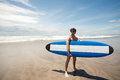 Strong young surf man portrait at the beach with a surfboard bali indonesia Royalty Free Stock Photos