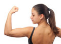 Strong young woman showing her muscles Royalty Free Stock Photography