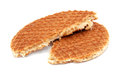 Stroopwafel dutch caramel waffle broken in half isolated on a white background Stock Image
