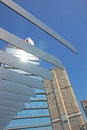 Structures with high rise building in background metal sun reflection on Royalty Free Stock Photography