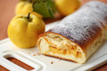 Strudel with quince sweet stuffed on the table Royalty Free Stock Photo