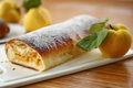 Strudel with quince sweet stuffed on the table Stock Photos