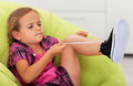The struggle - cute little girl ties shoe Royalty Free Stock Photo