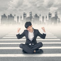 Struggle at modern city young asian businessman sit on ground and feel relax or Stock Image